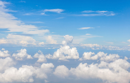 Beautiful fluffy white cumulus clouds in sunny blue sky.. photo