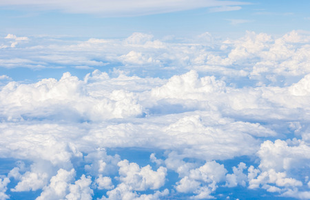 Beautiful cloudscape, on the heaven view over white fluffy clouds. photo