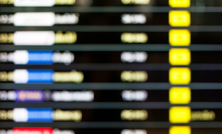 arrival departure board: Blurred background of display schedule board in an airport with departure and arrival times.