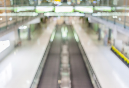 Blurred background of moving escalator in the Airport hall. photo