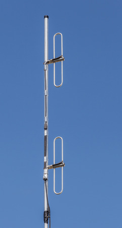 dipole: Dipole antenna for telecommunications with blue sky background.