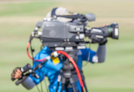 vdo: Blurred image of a man is recording VDO during golf tournament in golf course.