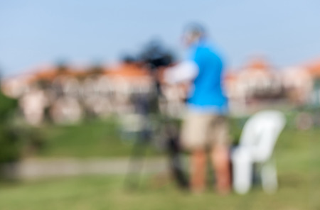 vdo: Blurred image of sport photographers working at the golf tournament for live  broadcasting.