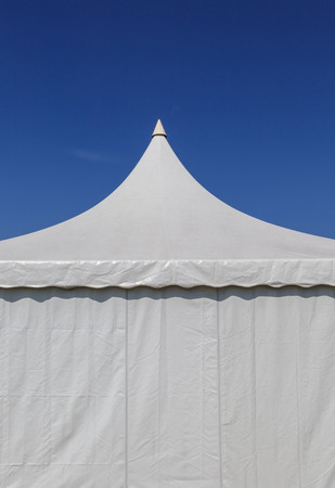 The white canvas tent for large event with blue sky background. Stock fotó