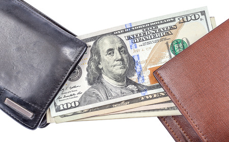 transferred: One hundred dollar blanknotes was transferred from old black wallet to new brown wallet on white background. Stock Photo