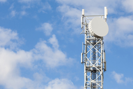 telecommunications: Telecommunications antenna tower for radio, television and telephony with beautiful blue sky.