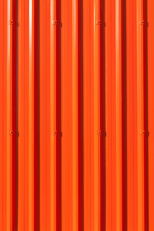 lively: Lively red corrugated painted metal wall background.