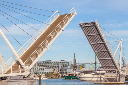 allow: Opened drawbridge allow all shipping through at the harbor.