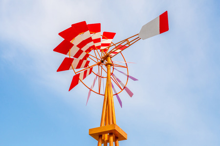 weathervane: The colorful weathervane over the blue sky background. Stock Photo
