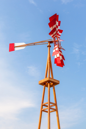 weathervane: The multicolor wind vane againsts beautiful clear blue sky.