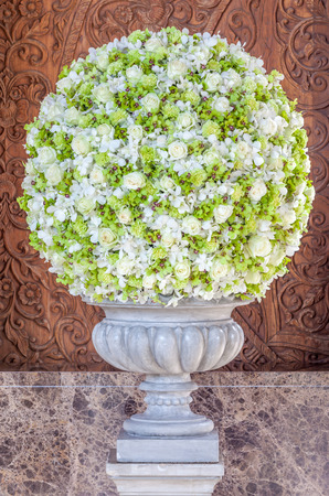orchid house: Beautiful flowers bouquet classic style in hotel reception. Stock Photo