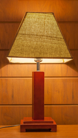 bedside: Shinning lamp on bedside table in the bedroom. Stock Photo