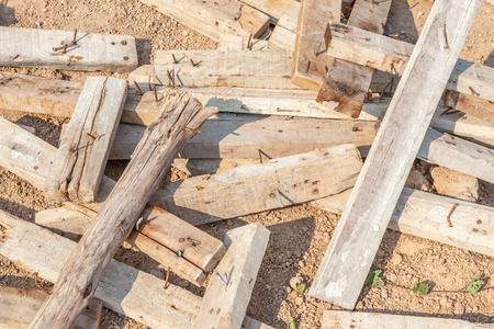 dirt pile: Waste pile of old used wood plank with dirt nails. Stock Photo