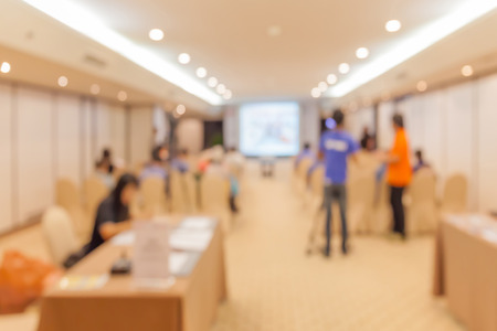 sociability: Blurred photo of audience group talking about business in conference event hall. Stock Photo
