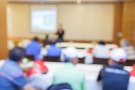 sociability: Blurred photo of audience group attending  in conference meeting room. Stock Photo