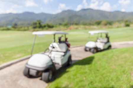 standby: Blurred photo of golf cart parks around golf course service standby for golfers.