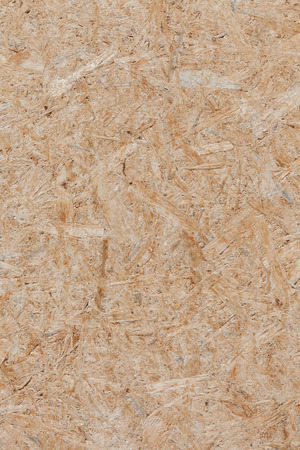 compressed: Background of compressed brown wooden texture. Stock Photo