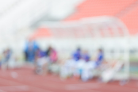 player bench: Blurred photo of soccer player and staff coach bench while break.