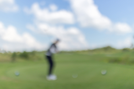unclear: Blurred photo of golf player on green with beautiful nature scene. Stock Photo