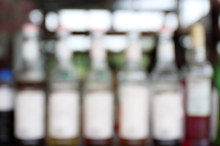 glucose: Blurred photo of colored bottle of fruity glucose syrup. Stock Photo