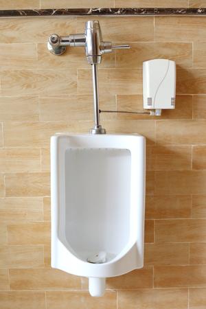 public restroom: Close-up white urinals in mens public restroom.