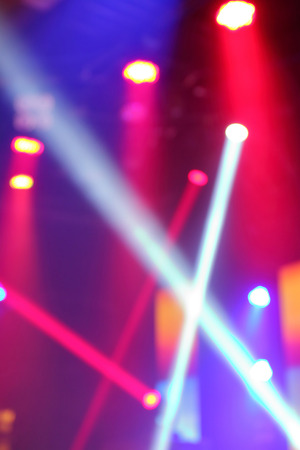 blue background: Blurred photo of stage lights in live concert hall. Stock Photo