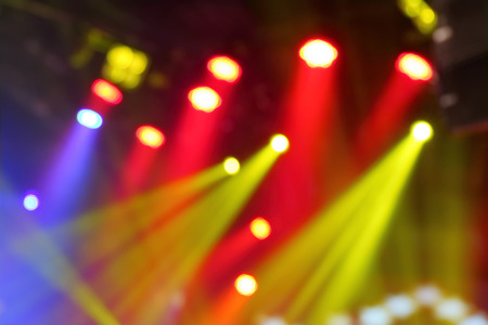 lighting background: Abstract blurred photo of colorful stage lights.