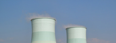 cleared: Smoking pipes of thermal power plant with cleared sky background. Stock Photo