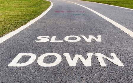 The warning sign to slow down marked on street, safety concept. Stock Photo