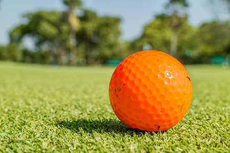 Close up the dirt golf ball on grass with blurred green golf course background. Stock fotó