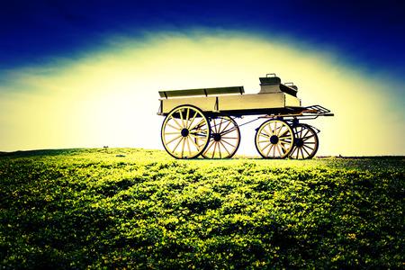 old wood farm wagon: Vintage photo of beautiful wagon in beautiful nature scene farmland.