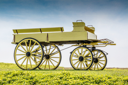 old wood farm wagon: A uncovered wagon retro style in beautiful nature scene farmland.