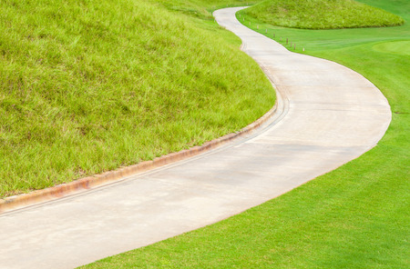 sidewalks: The curved pathway green golf course and beautiful nature scene. Stock Photo