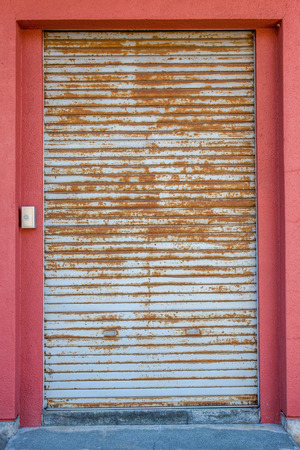 oxidize: The rust corrugated grey metal door, use as background. Stock Photo