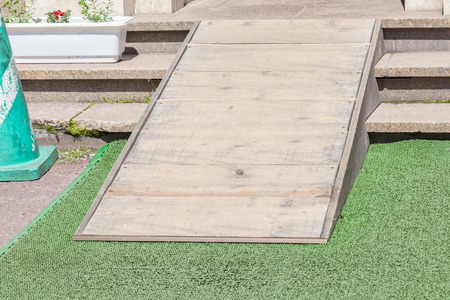 wheelchair access: Wooden ramped access, using wheelchair ramp for disabled people. Stock Photo