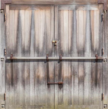 Retro entrance door with rustic locked bolt in Farmland.