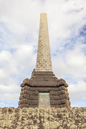 Auckland, New Zealand- December 1, 2013. Obelisk memorial of Sir John Logan Campbell on one tree hill in Auckland.
