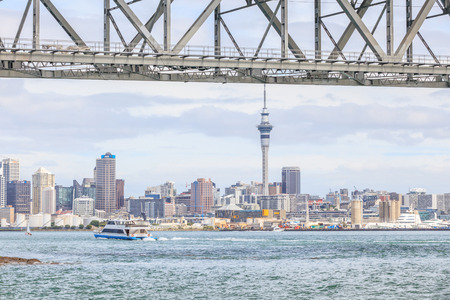 Auckland, New Zealand- December 10, 2013. Auckland city and sky tower view from the Auckland harbor bridge. Editorial