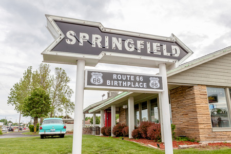 western usa: Springfield Missouri, USA- May 18, 2014. Springfield road arrow sign with cafe background in best western route 66 rail haven. Editorial