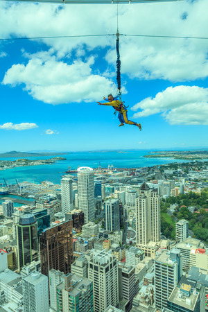 Auckland, New Zealand- December 12, 2013. A man bungee jumping from Auckland sky tower.