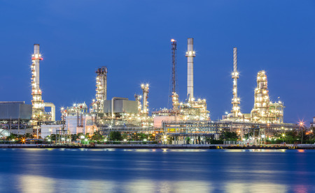 petrochemistry: Scenic of oil refinery plant of Petrochemistry industry in twilight time and reflection in near river in Bangkok, Thailand.