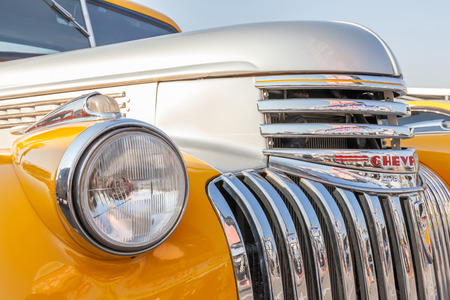 Bangkok, Thailand -February 11, 2017: The front view of vintage classic yellow Chevrolet pickup truck shown in vintage automobile festival. 報道画像