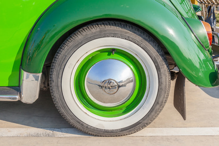 Bangkok, Thailand –February 11, 2017: Close-up wheel and logo of classic beetle green Volkswagen the popular German car manufacture. Editorial