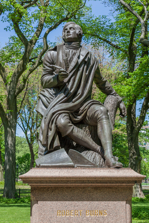 poems: New York, USA- May 20, 2014. Memorial Scottish poet Robert Burns statue in Central Park, New York City, USA.
