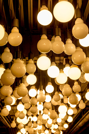 retail scene: Group of Edison light bulbs hanged from ceiling in department store. Stock Photo