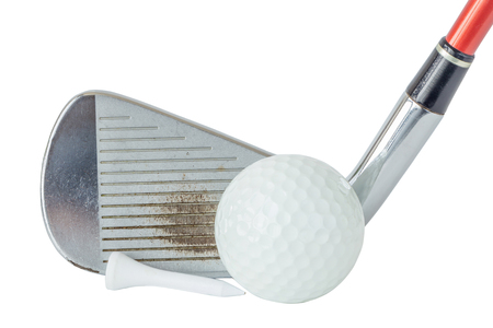 off course: Close up the old metal golf club and ball with tee set on white background, golf sport equipment concept.