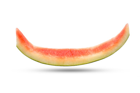Slice of watermelon rind after eaten up on the white background and the shadow below. Stock Photo