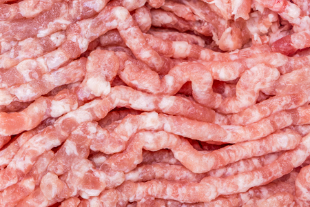 veal sausage: Detail of fresh and raw minced pork from supermarket, fresh food ingredients concept.