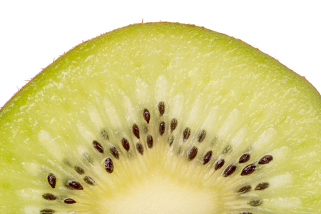 Close up detail of fresh juicy kiwi slice and white background on above, healthy eating concept.