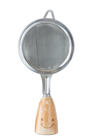 The small sieve colander with wooden handle and smile isolated on white background, kitchen utensil concept.